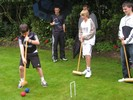Playing croquet, undeterred by the rain